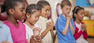 chldren praying.jpeg